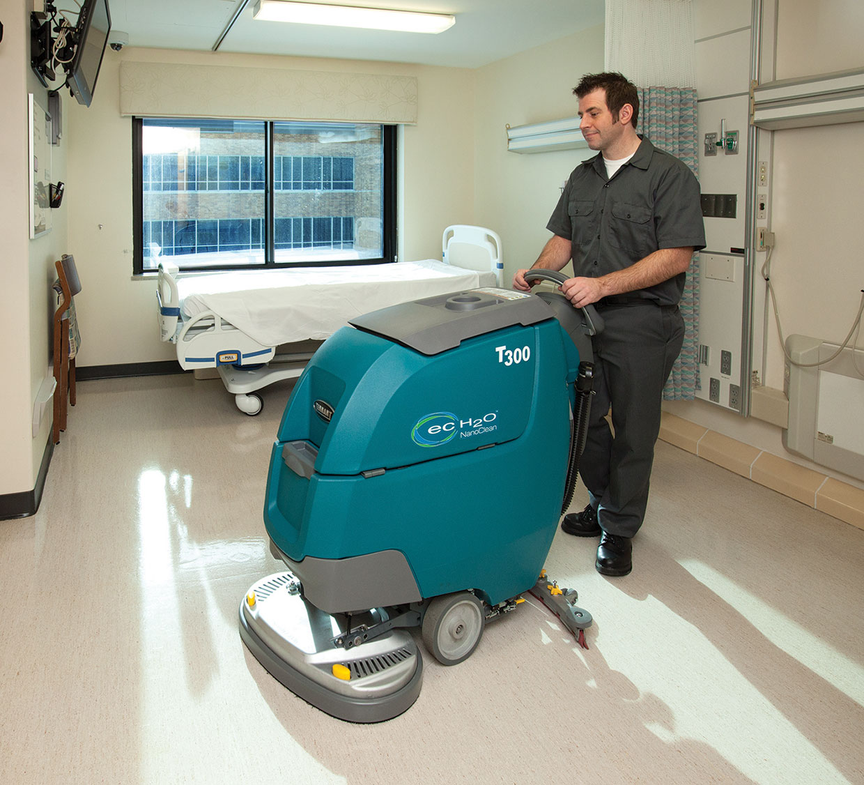 Cleaning a patient room with a scrubber