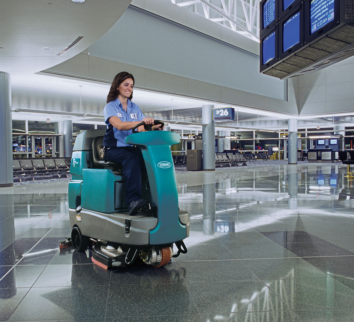 Cleaning industry employee cleaning airport with T7 Rider Scrubber