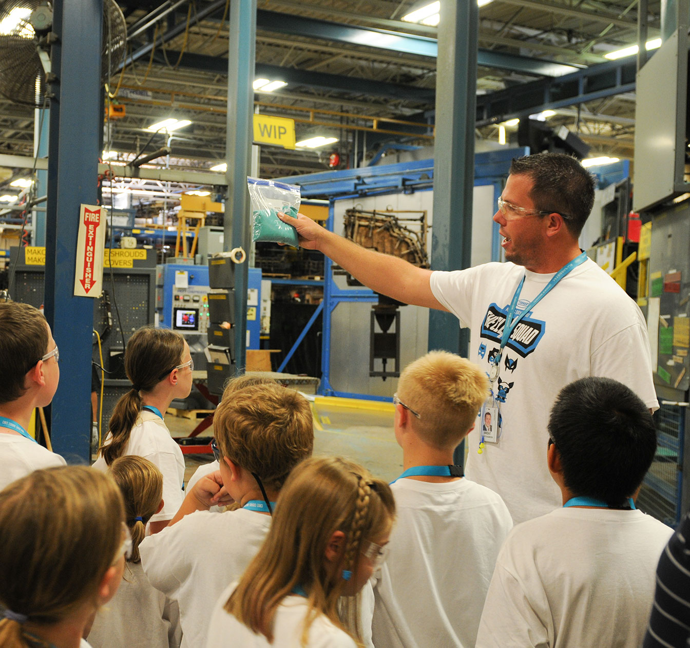 A Tennant employee giving a tour of the manufacturing plant.