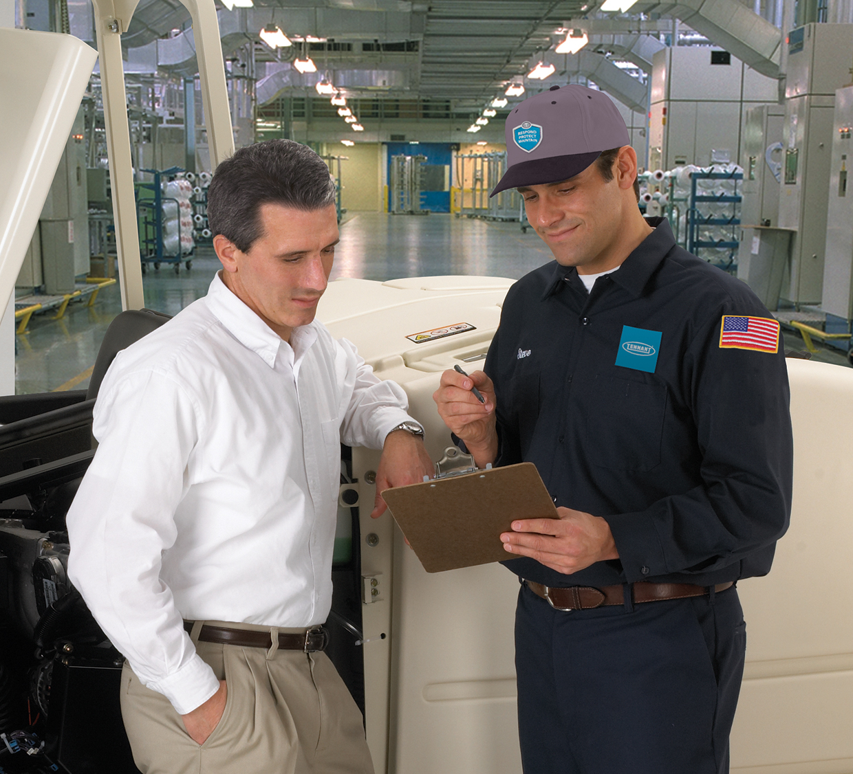 Service Technician and Customer viewing planned maintenance information