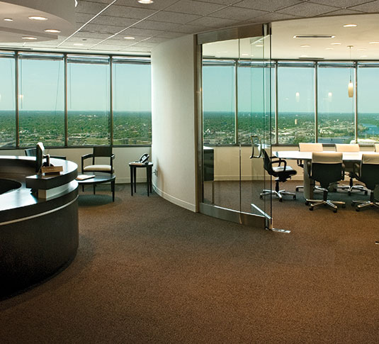 Office with carpeted flooring