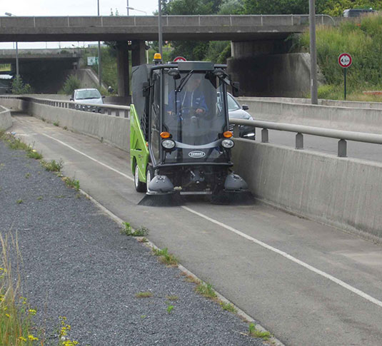 Green Machines 636 air sweeper cleaning streets