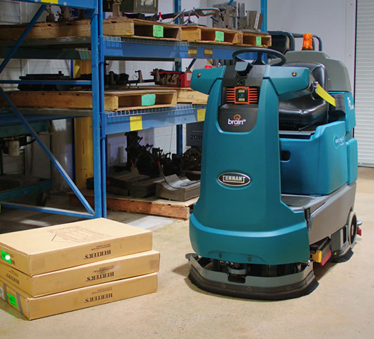 Tennant T7ARM Robotic Floor Cleaning Machine cleaning in mall with cleaning professional