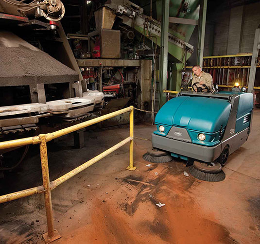 S20 Compact Mid-Sized Rider Sweeper in a manufacturing plant.