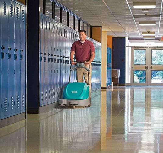 S5 Walk-Behind Sweeper cleaning in a school
