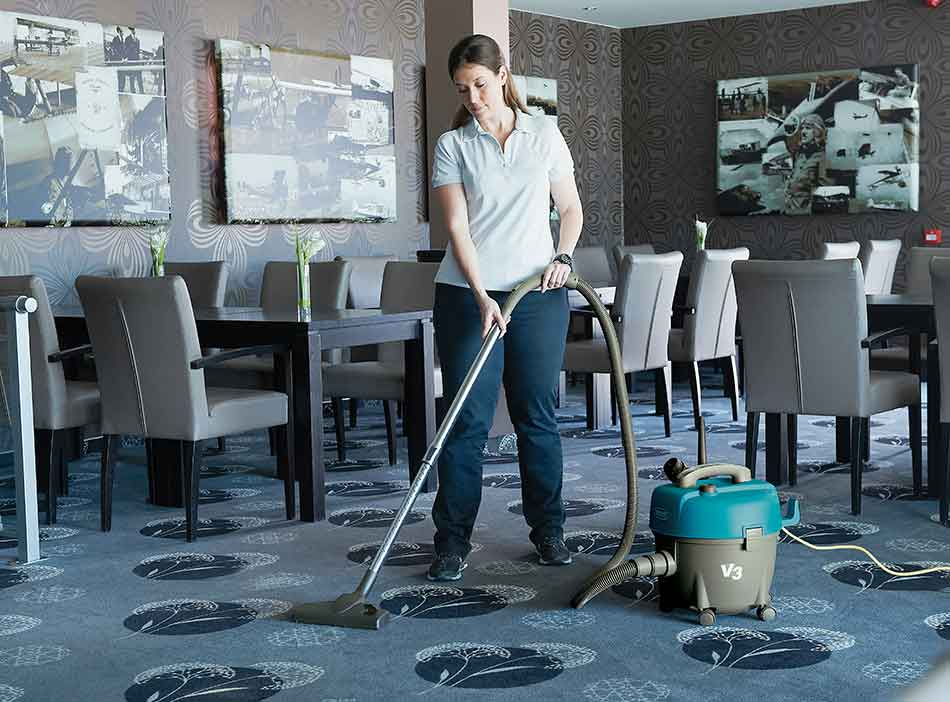 Tennant vacuum cleaning floor of restaurant
