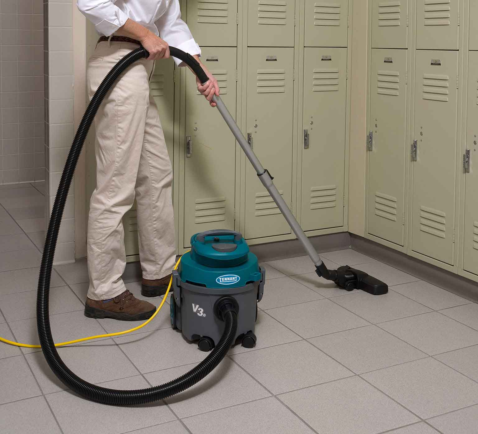 V3e Dry Canister Vacuum cleaning a locker room.