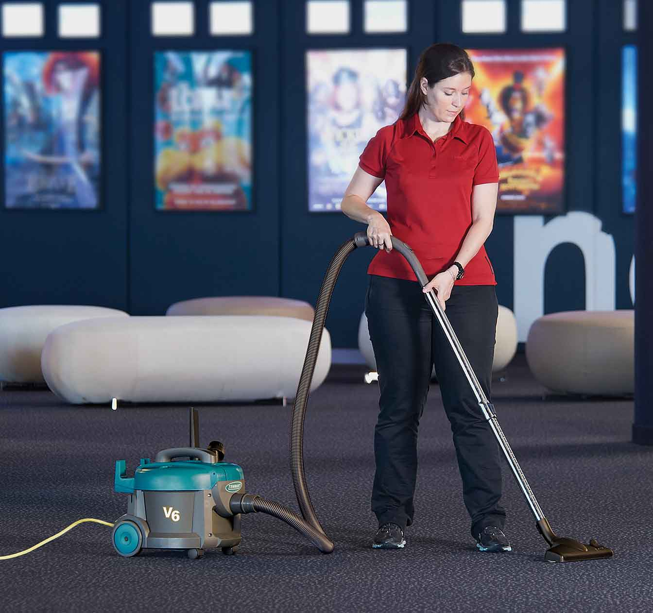 V6 Dry Canister Vacuum cleaning a movie theater.